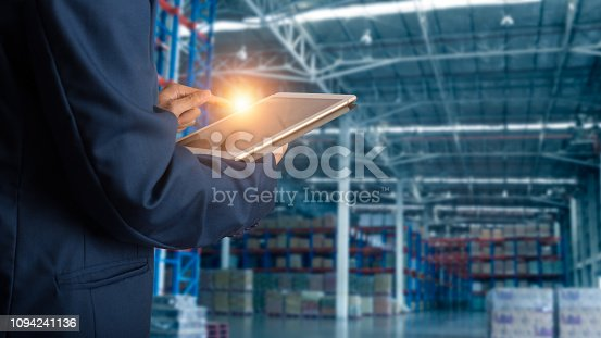 istock Businessman manager using tablet check and control for workers with Modern Trade warehouse logistics. Industry 4.0 concept,planning of logistics, Transportation within the country and Global. 1094241136