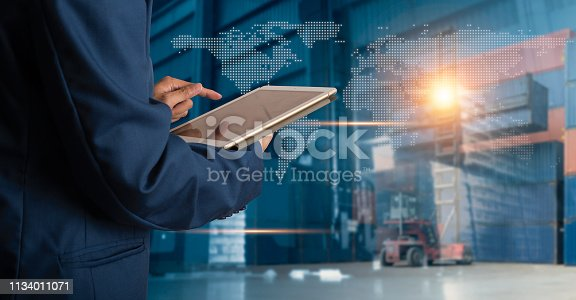 istock Businessman manager using tablet check and control for workers with Modern Trade warehouse logistics. Industry 4.0 concept 1134011071