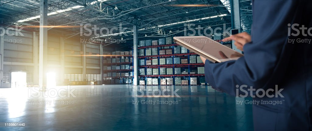 Businessman manager using tablet check and control for workers with Modern Trade warehouse logistics. Industry 5.0 concept Businessman manager using tablet check and control for workers with Modern Trade warehouse logistics. Industry 5.0 concept Audit Stock Photo