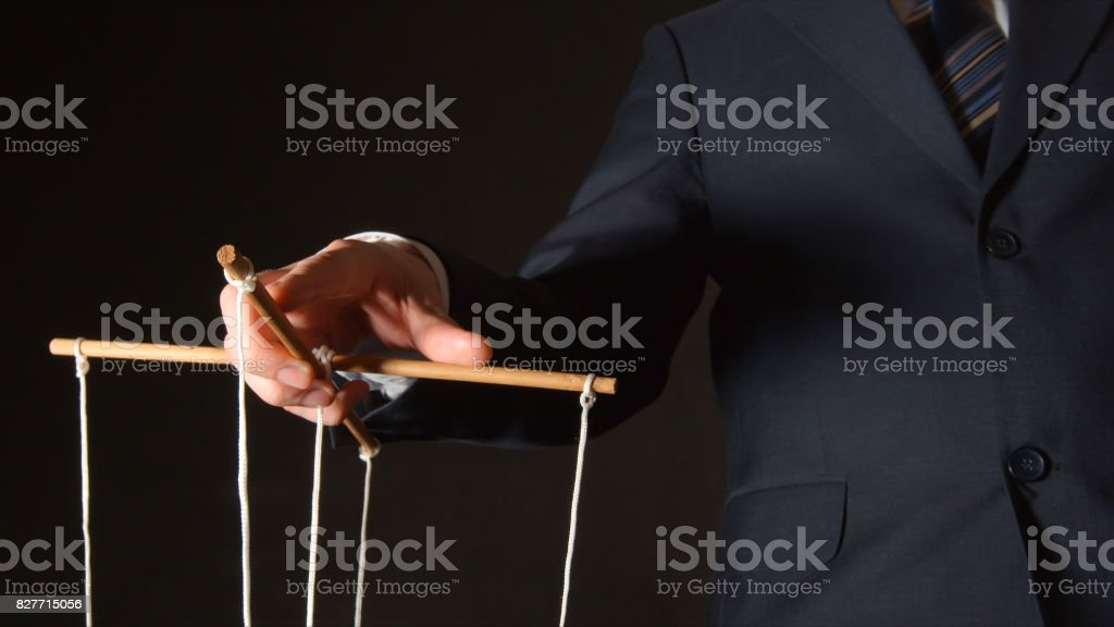 MANIPULATION: Businessman manipulating stock photo
