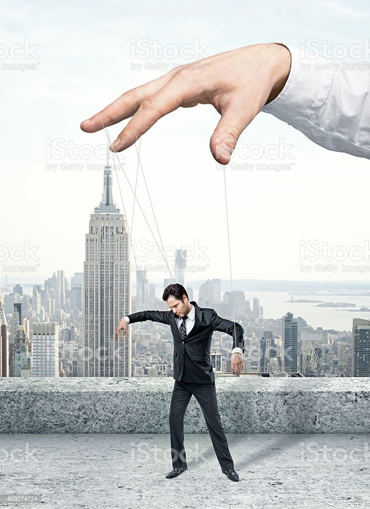 Businessman marionette stock photo