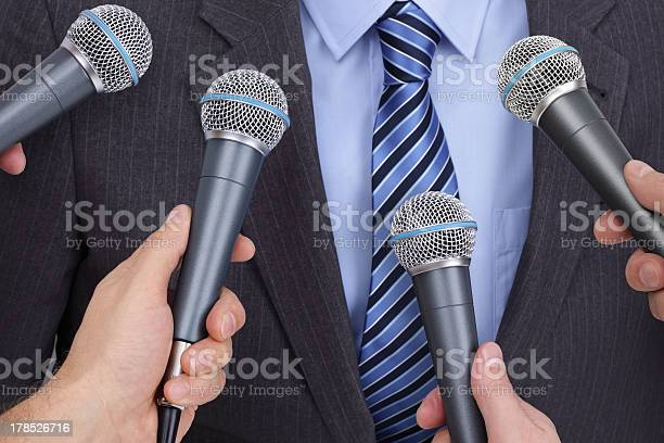 Businessman Media Contact Being Interviewed Stock Photo - Download Image Now