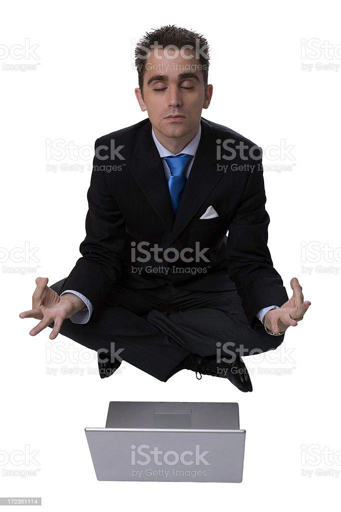 Businessman meditating royalty-free stock photo