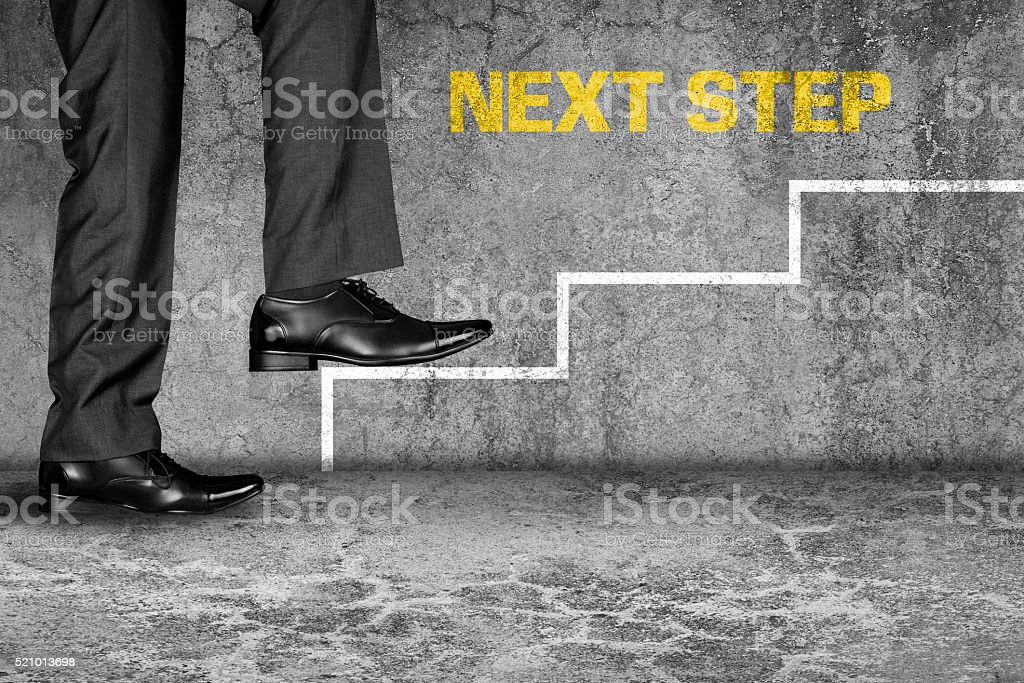 Businessman moving up on stairs stock photo