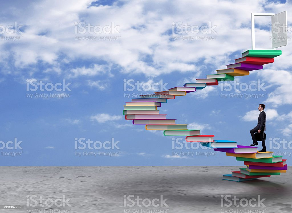 Side profile of a businessman walking up on books of staircase. Man...