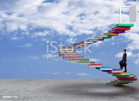 istock Businessman moving up on steps to achieve success 583967232