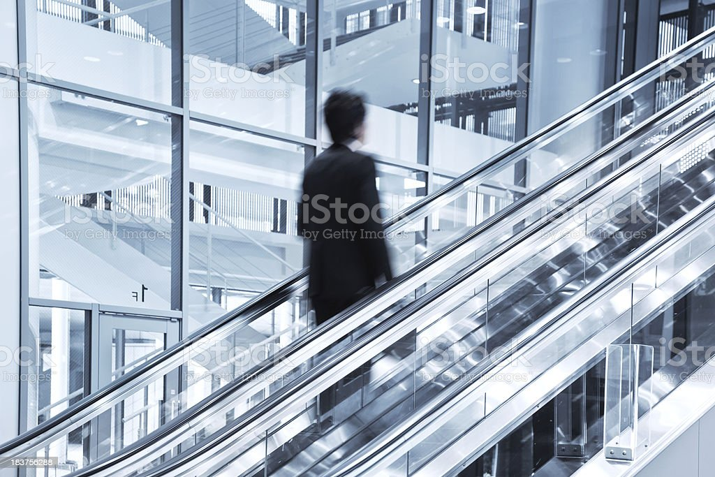 Businessman moving up royalty-free stock photo