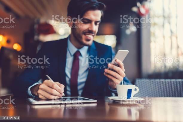 Businessman multitasking on coffee break picture id924121824?b=1&k=6&m=924121824&s=612x612&h=tjetpawkwfwvzhiakz0vogoldaydpqbej6mmrjlqs4i=