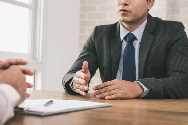 Businessman negotiating with client at the table stock photo