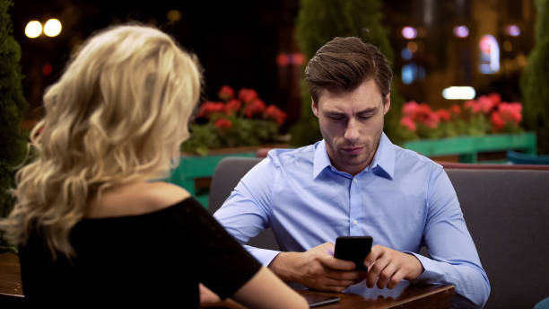 Businessman not paying attention to his girlfriend, addicted to gadget, problem Businessman not paying attention to his girlfriend, addicted to gadget, problem ignoring stock pictures, royalty-free photos & images