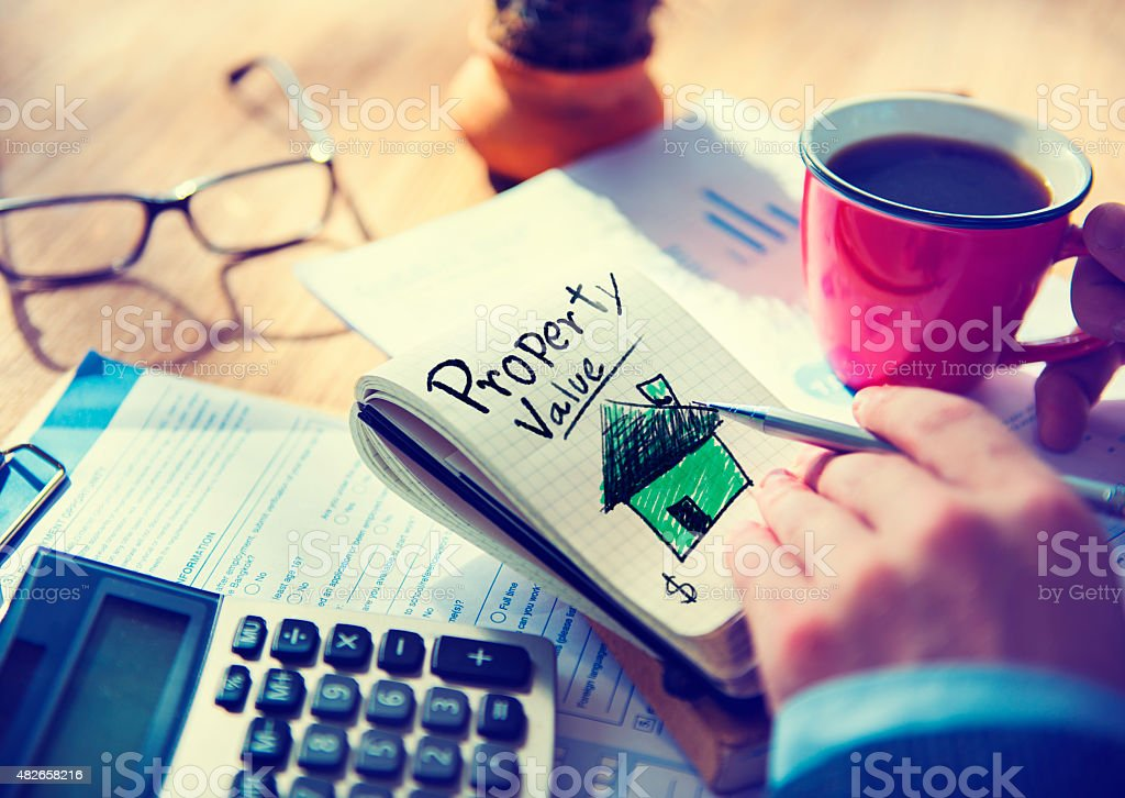 Businessman Notepad Property Value Concept stock photo