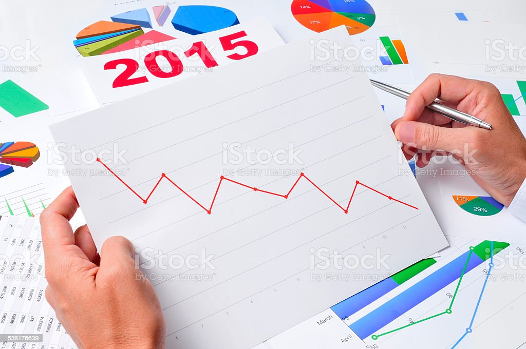 businessman observing a chart with a downward trend stock photo