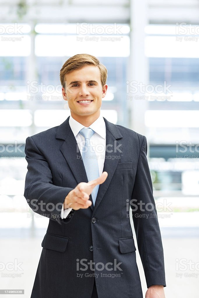 Businessman Offering a Handshake royalty-free stock photo