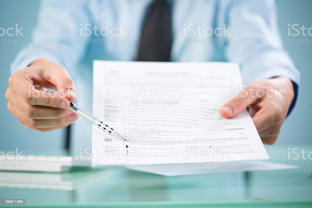 Businessman Offering Document For Signing royalty-free stock photo