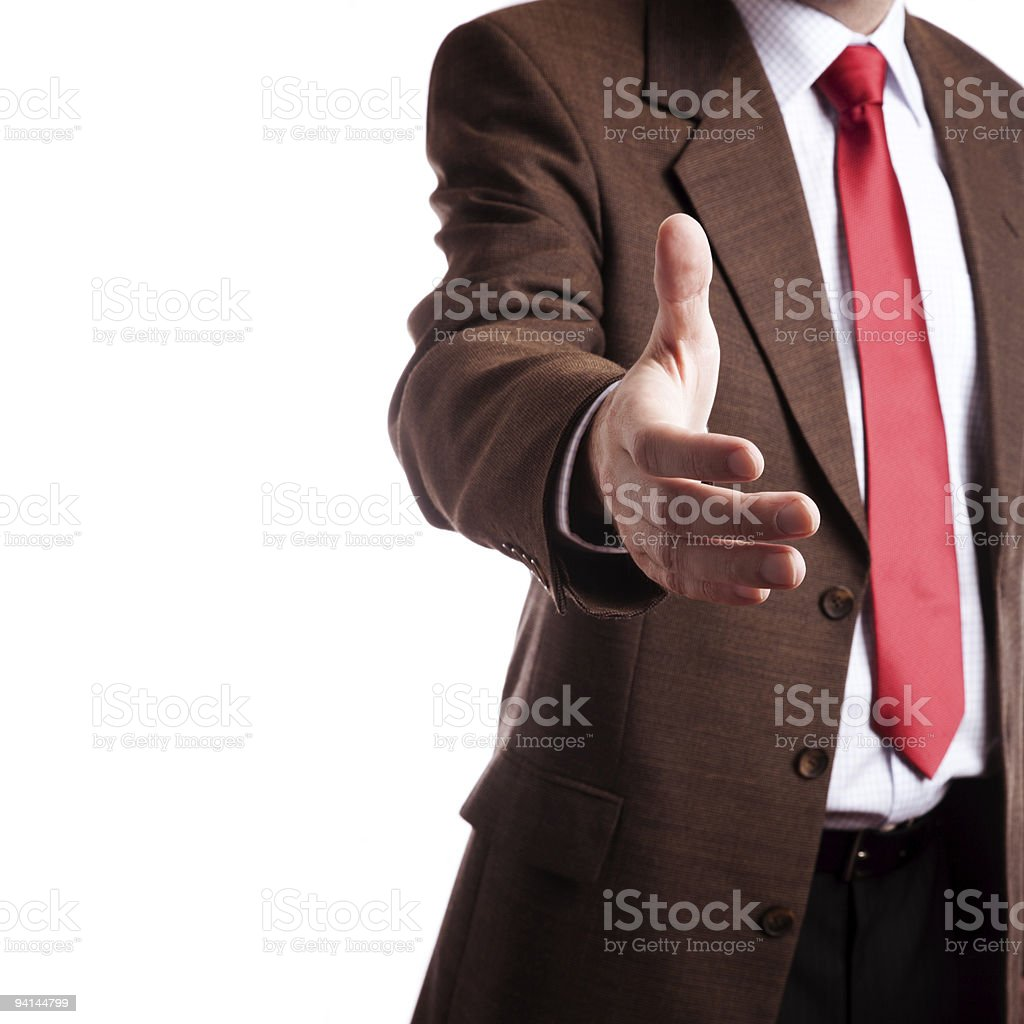 Businessman offering hand to shake to the camera royalty-free stock photo
