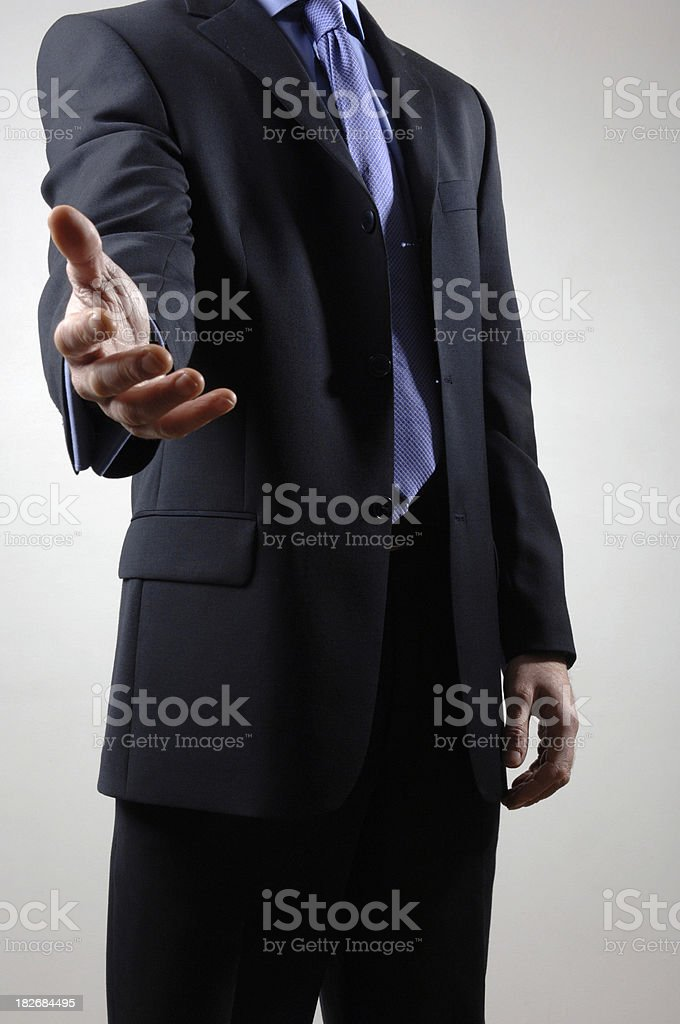 Businessman offering open hand royalty-free stock photo