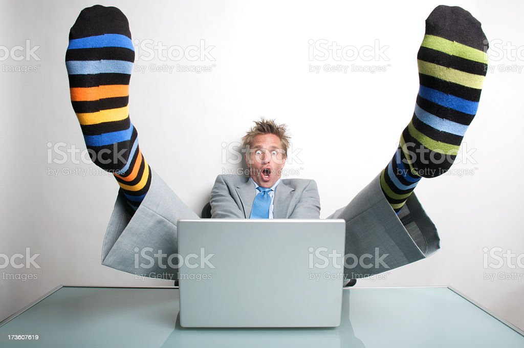 Businessman Office Worker Almost Gets His Socks Shocked Off stock photo