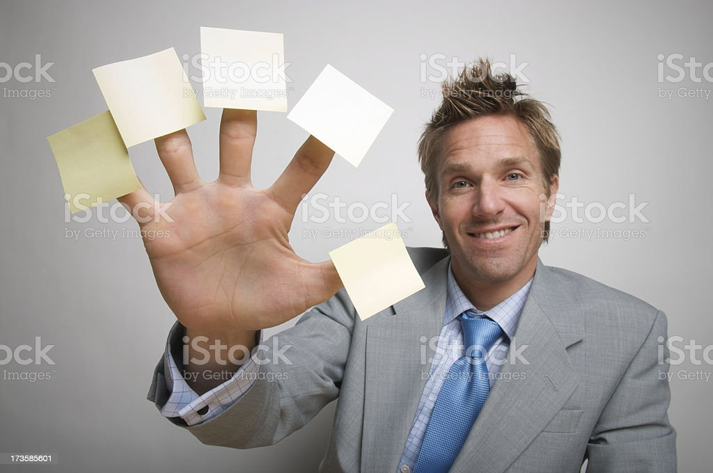 Businessman Office Worker Holds Five Friendly Reminders Sticky Notes royalty-free stock photo