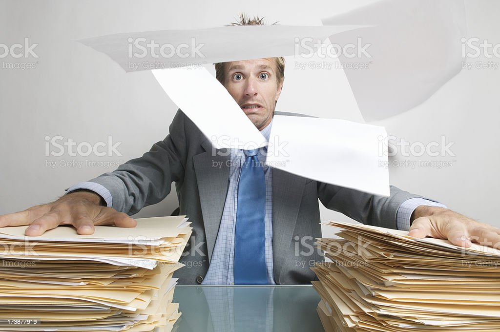 Businessman Office Worker Holds On to his Paperwork royalty-free stock photo