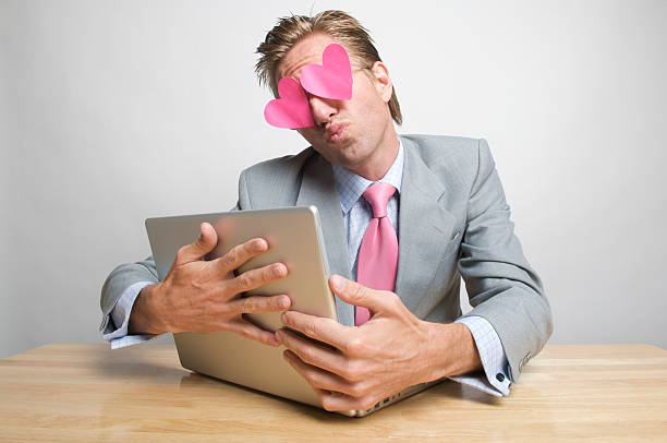 Businessman Office Worker Pink Hearts Hugging Kissing Laptop stock photo