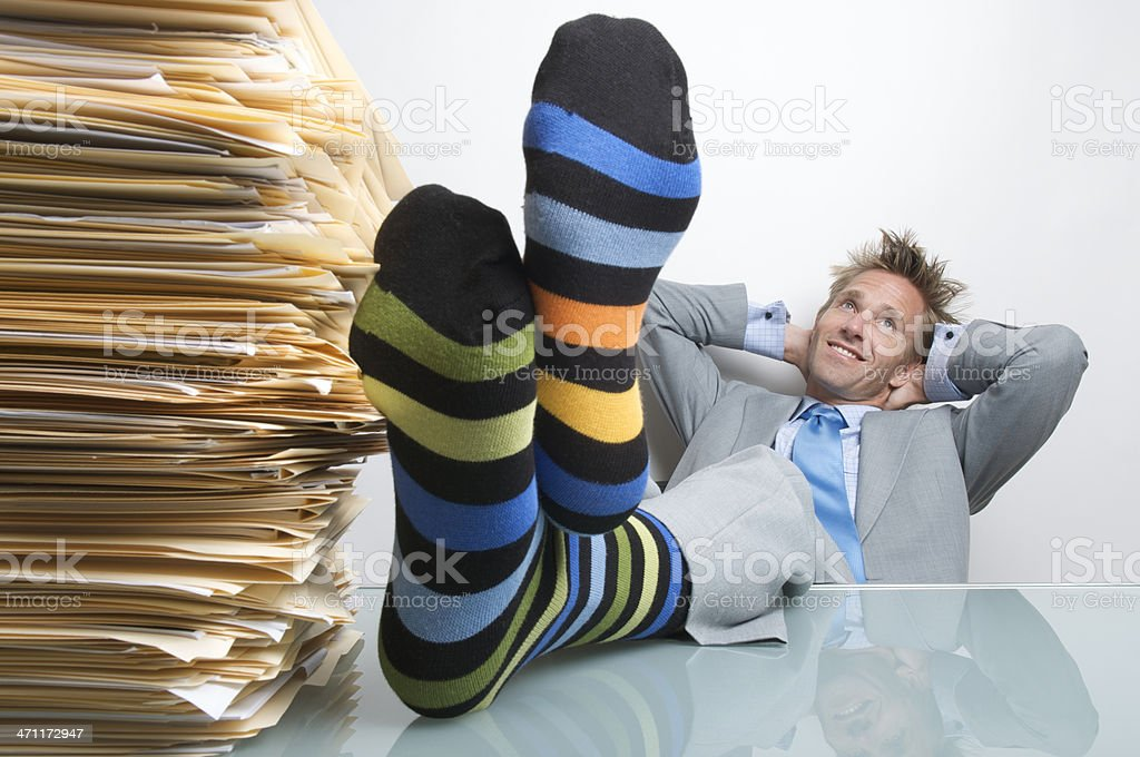 Businessman Office Worker Reclining at Desk Socks Up Dreaming royalty-free stock photo