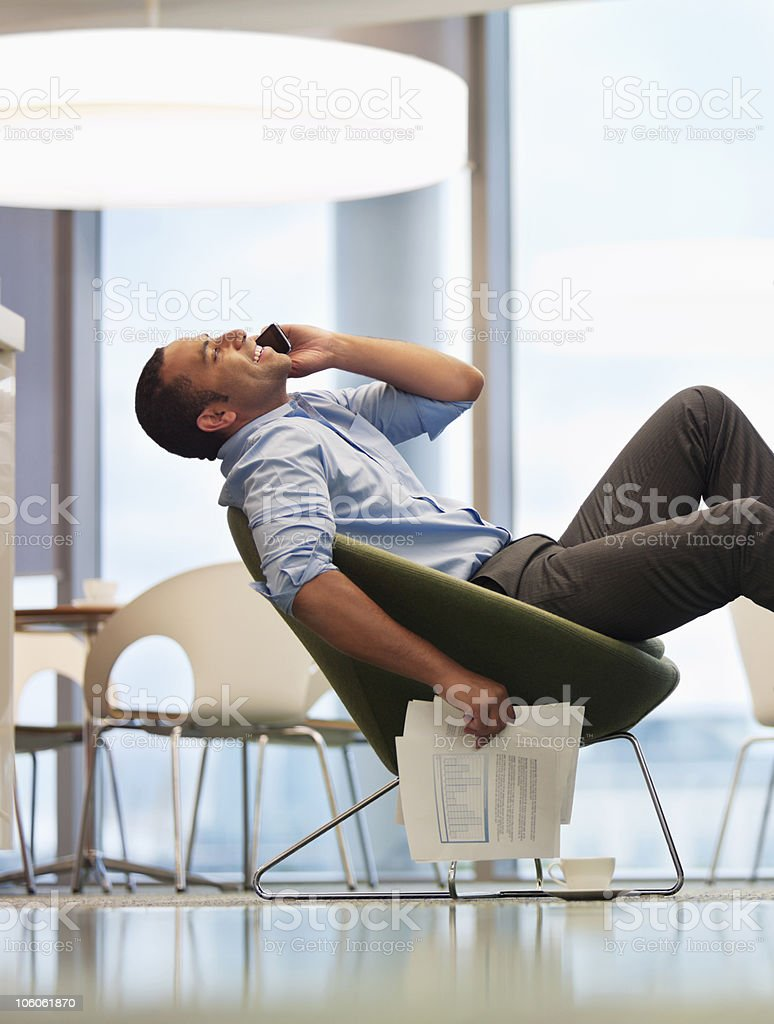 Businessman on a call during his office break, side view royalty-free stock photo