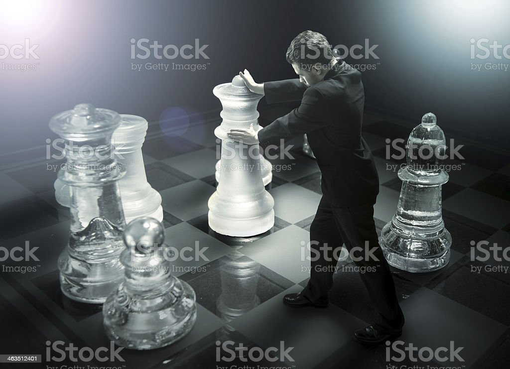Businessman on a chessboard as  dummy stock photo