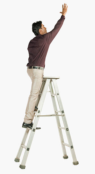 businessman on a ladder - ladder stock photos and pictures