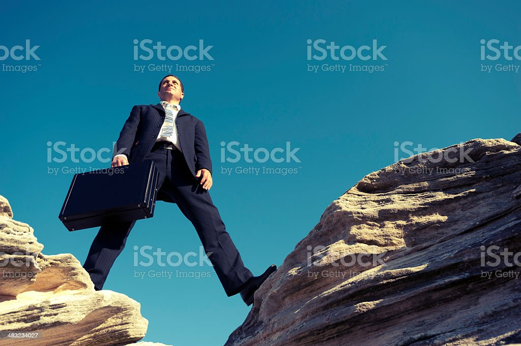 Businessman on a mountain top royalty-free stock photo
