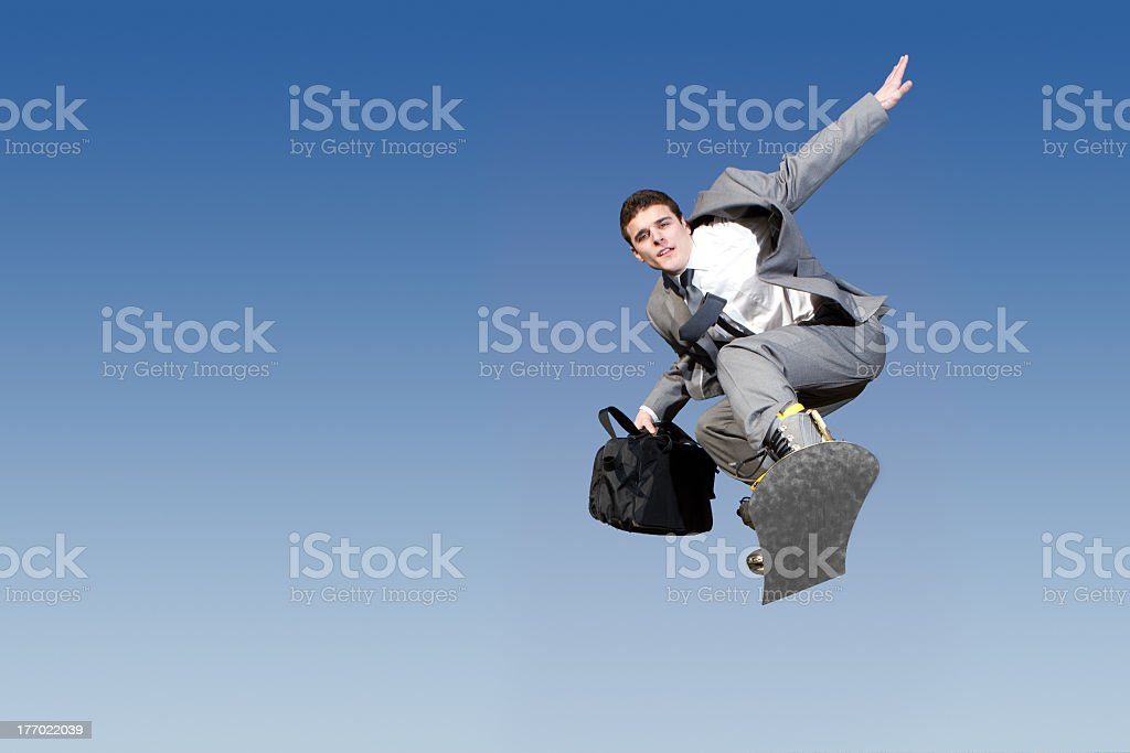 Businessman on a Snowboard royalty-free stock photo