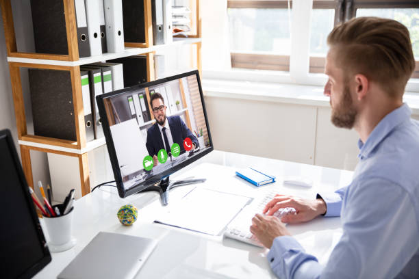 businessman on a video or conference call on his computer - virtual meeting стоковые фото и изображения