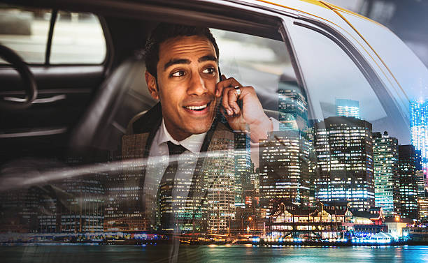 businessman on a yellow cab in new york city - business travel stock photos and pictures