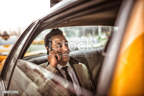 istock Businessman on a yellow cab 469872055