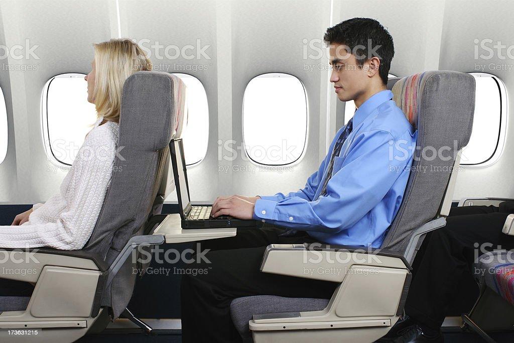 Businessman On Airplane royalty-free stock photo
