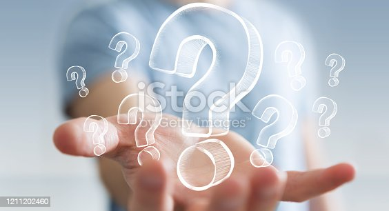 Businessman on blurred background holding hand drawn question marks