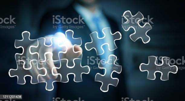 Businessman on blurred background touching handdrawn puzzle pieces picture id1211201428?b=1&k=6&m=1211201428&s=612x612&h=hmysx1mqpmaphvwadnlv1qxqsmzhsqo3fb9u t9 i1g=