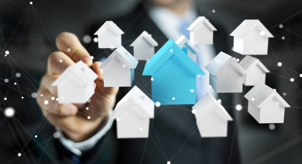 Businessman on blurred background using 3D rendered small white and blue houses Businessman on blurred background using 3D rendered small white and blue houses place of worship stock pictures, royalty-free photos & images
