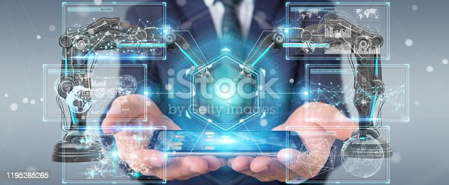 istock Businessman on blurred background using robotics arms with digital screen 3D rendering 1195265265