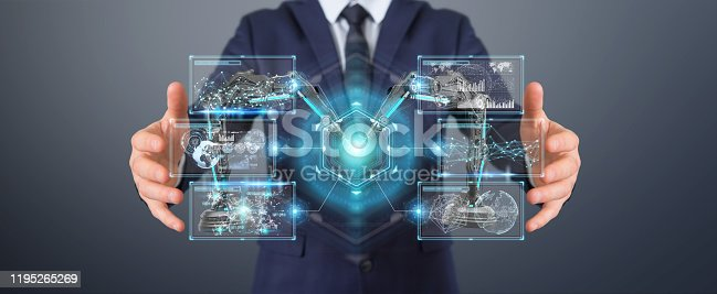 istock Businessman on blurred background using robotics arms with digital screen 3D rendering 1195265269