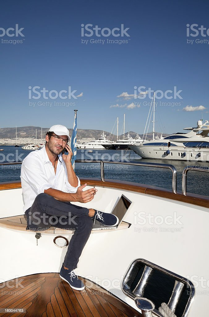 Businessman on board of the yacht royalty-free stock photo