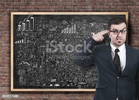 istock Businessman on business strategy planning on blackboard 863317496