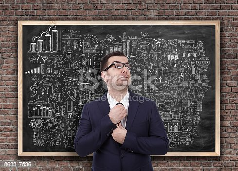 istock Businessman on business strategy planning on blackboard 863317536