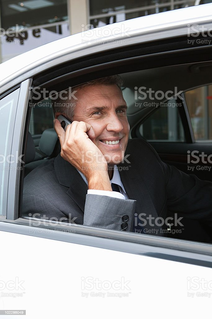Businessman on cellphone in car royalty-free stock photo