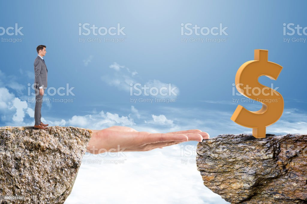 Businessman on cliff with dollar sign on other side stock photo