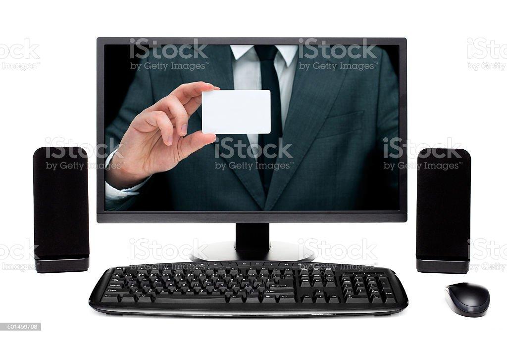 Businessman on desktop computer monitor showing card stock photo
