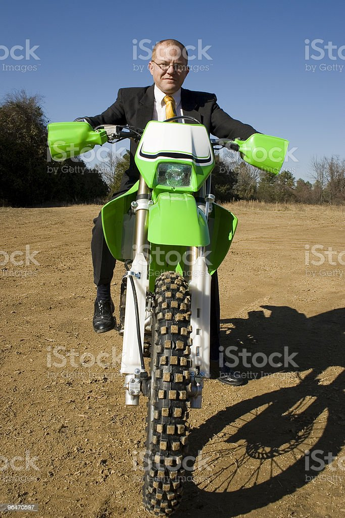 Businessman on Dirt Bike royalty-free stock photo