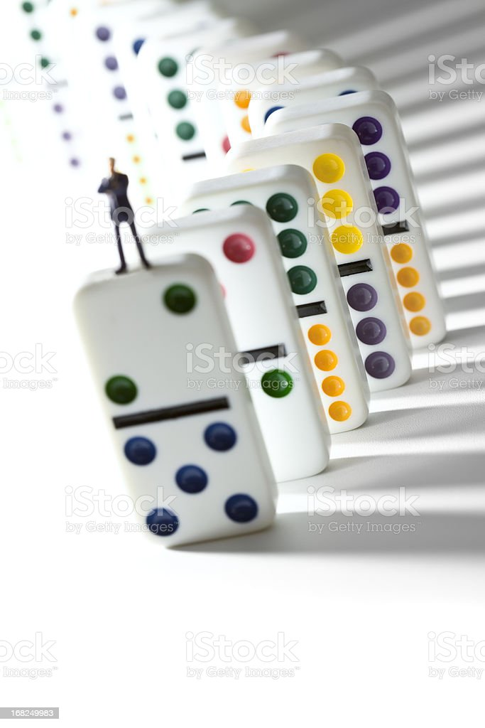 Businessman on dominos stock photo