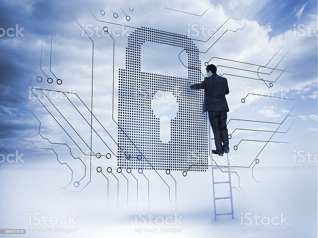Businessman on ladder touching a padlock Businessman on a ladder touching a padlock next to circuit board with blue sky on the background 20-24 Years Stock Photo