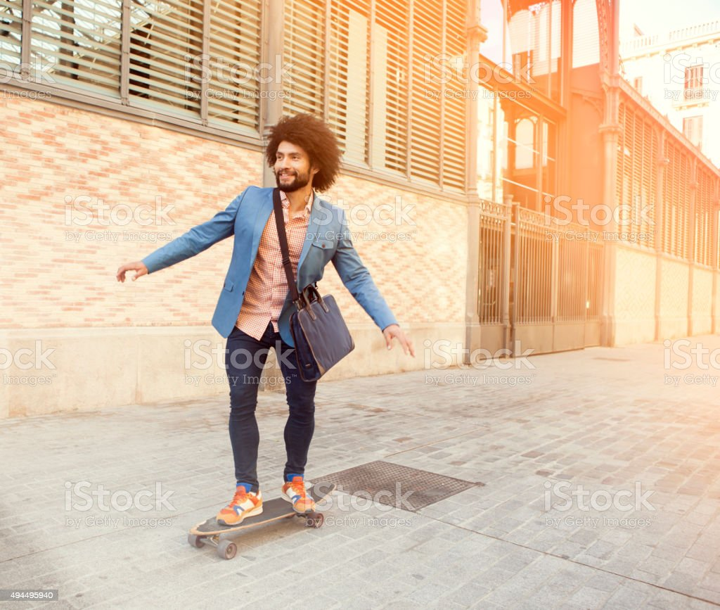 Businessman on longboard stock photo