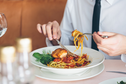 Businessman On Lunch Break Eating Pasta Stock Photo - Download Image Now